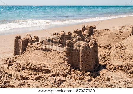 Sand Castle On The Sea Shore
