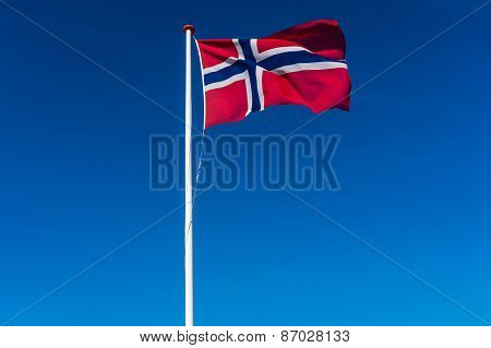 Norwegian Flag On The Blue Sky