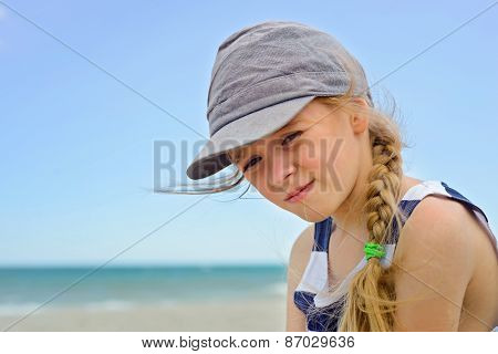 Portrait of beautiful small girl in denim hat