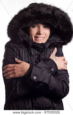 Girl with coat shivering