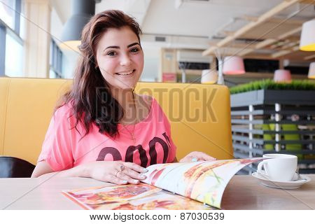 Pretty woman looking at the menu at a restaurant
