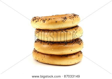 Several Poppy Bagels Stacked