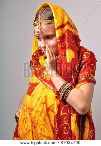 Little Girl In Traditional Indian Saree Tikka And Bandles