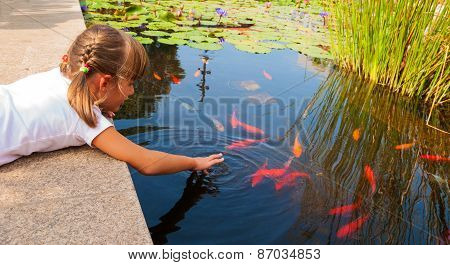 Little girl and fish