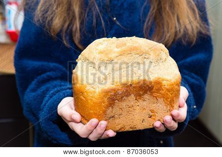 Girl In A Blue Dressing Gown Holding Homemade Bread
