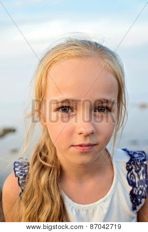 Portrait of little cute girl on sunset