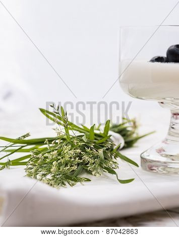 Small bouquet of wild grass and yogurt with blackberry