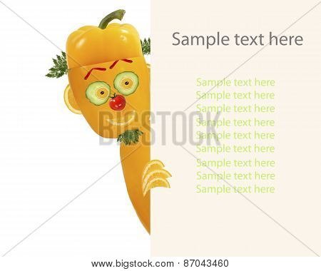 Creative Food Concept. Little Funny Pepper Looks  And Smiles With Sample Text.