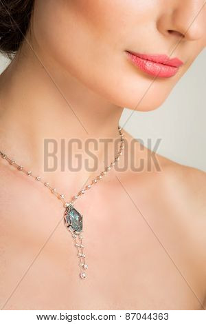Closeup Of Beautiful Young Woman With Necklace And Ring