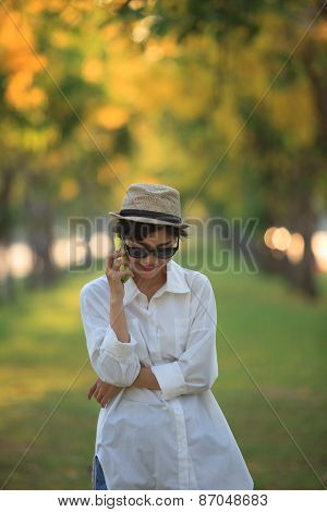 Beautiful Young Woman Wearing Sun Glassea Nd Straw Hat Talking On Mobile Phone With Happiness Emotio