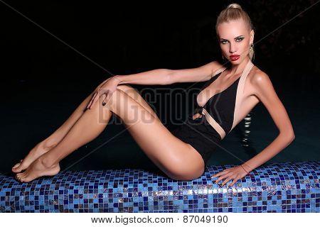 Beautiful Sexy Woman Relaxing In Night Swimming Pool