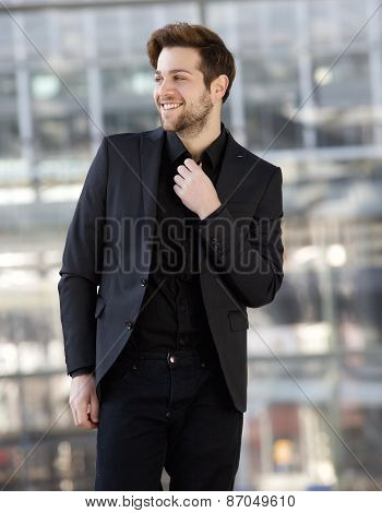 Confident Young Man Smiling With Black Clothes
