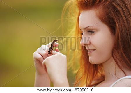 Girl Holds Brown Caterpillar On Her Hand