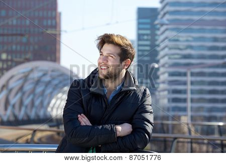 Young Man Smiling With Winter Jacket In The City