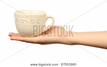 Female hand holding cup isolated on white