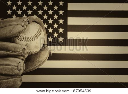 Worn Baseball Glove And Used Ball On American Flag