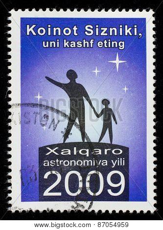UZBEKISTAN - CIRCA 2009: A stamp printed in Uzbekistan devoted to the World Year of Astronomy, circa 2009