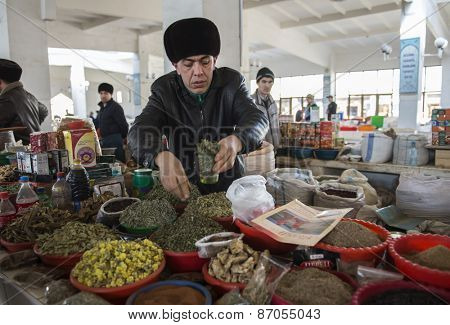 BUKHARA, UZBEKISTAN - MARCH 16, 2015: City grocery market. A man sells tea and herbs.
