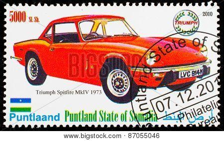 SOMALIA - CIRCA 2010: Postage stamp printed in Somali republic shows retro car,  Triumph Spitfire MKIV 1973,circa 2010.