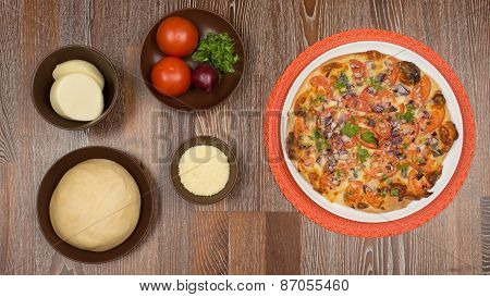 Pizza And The Ingredients For Cooking