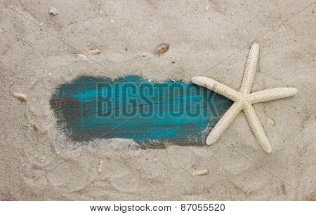Blank blue sign on sand beach by starfish