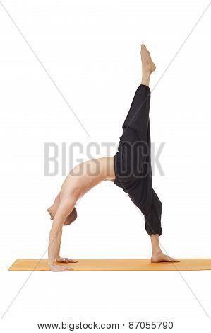 Yoga lessons. Man posing in difficult asana