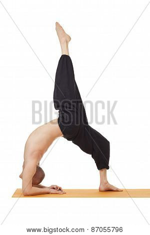 Yoga exercise. Instructor posing in difficult pose