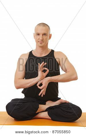 Yoga instructor posing with hands in mudra