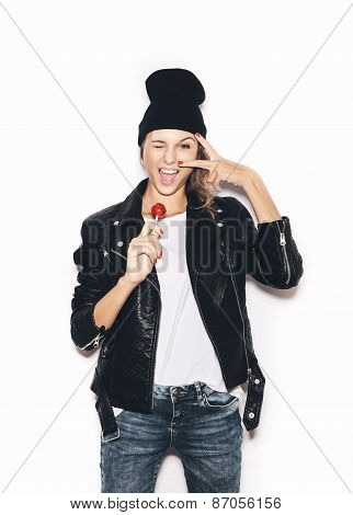 Funky Hipster Girl Woman Saluting, Winking And  Sucking Lollipop