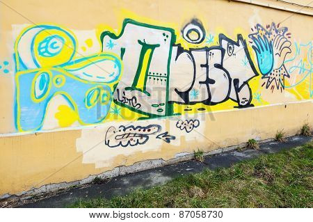 Graffiti Fragment On The Yellow Wall