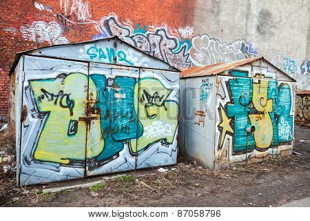 Two Old Rusted Garages With Colorful Grungy Graffiti