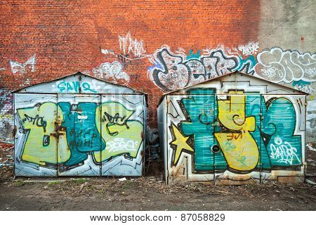 Old Rusted Garages With Colorful Grungy Graffiti