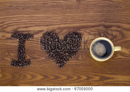 letters from beans and cup of coffee