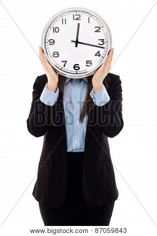Businesswoman Covering Her Face With A Clock