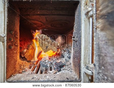 Burning Fire Inside A Heater With Stove