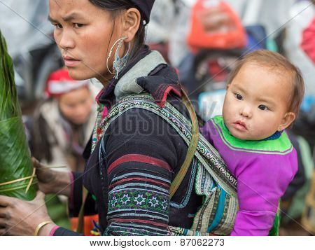 Hmong woman with a child