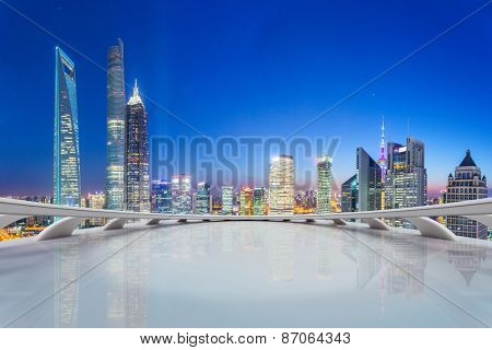 modern city skyline,illuminated skyscraper looking from futuristic office building interior