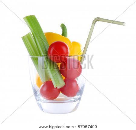 Vegetables in glass with tube isolated on white