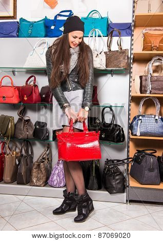 Beautiful Woman Choosing Red Leather Bag