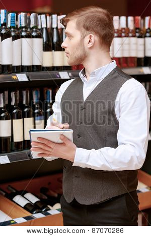 Sommelier with a note pad