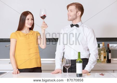 Woman looks at the wine in glass