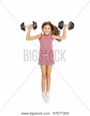 High Point View Of Girl Lying On Floor And Doing Exercise With Dumbbells