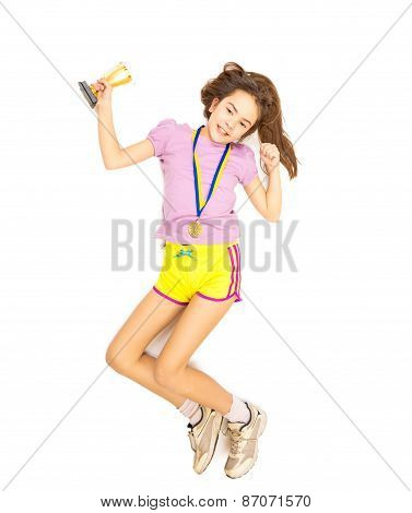 Isolated Shot Of Happy Girl Jumping With Trophy Cup And Gold Medal