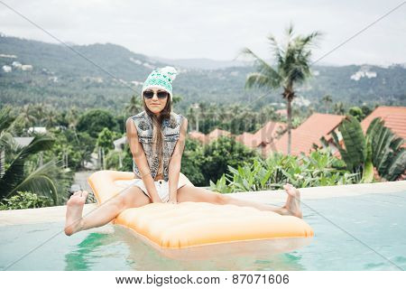 Young Pretty Fashion Sport Woman Posing Outdoor On Pool Party