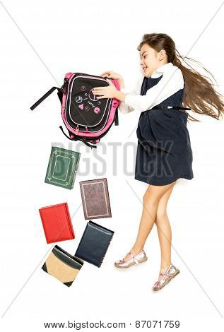 Isolated Shot Of Cute Schoolgirl Emptying Backpack Full Of Book
