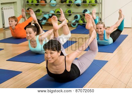 Women Of Different Age Practicing Yoga