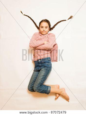 Isolated Photo Of Sad Girl With Long Braids Lying On Floor
