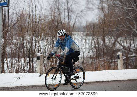 Man riding his bike