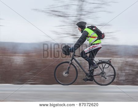 Man riding his bike. Panning