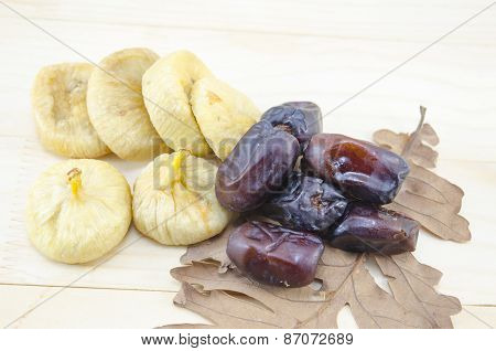 Dried Figs And Date Palms On A Wooden Table